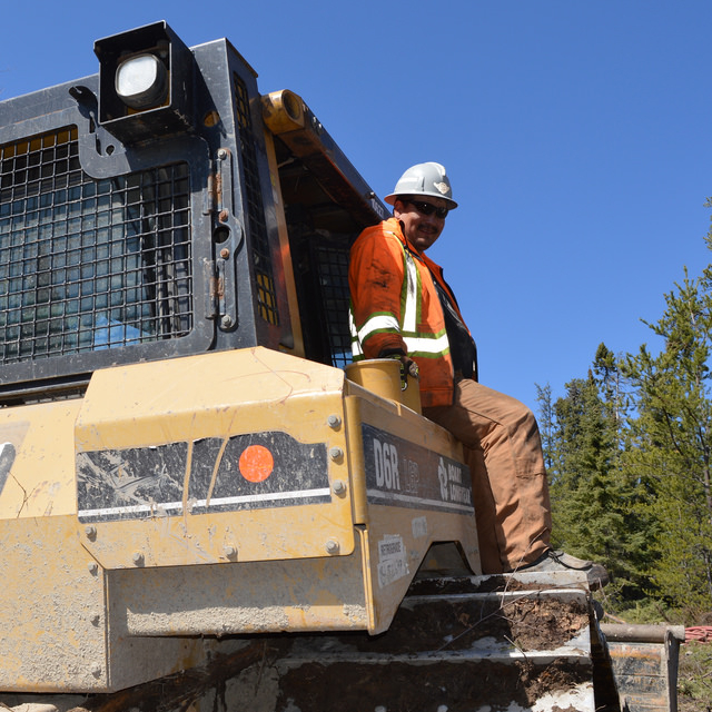 Avalon employee at the spring drilling program.