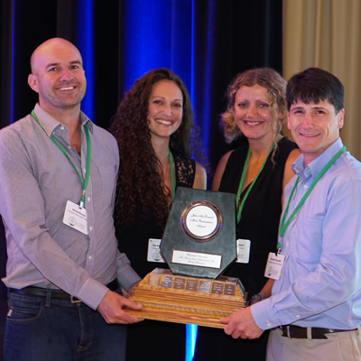 Chris Hercun, Sarah Whitehouse, Jaimie Dickson and Richard Doucette of Teck Highland Valley Copper Partnership receive the Jake McDonald Annual Mine Reclamation Award in Williams Lake on September 19.