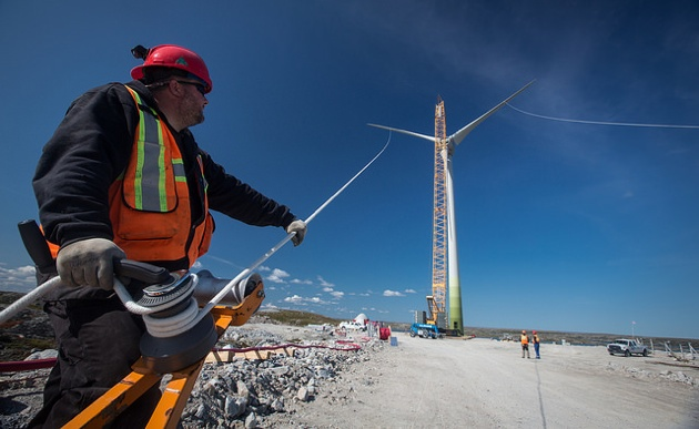 A group working together to assemble one of the wind turbines.