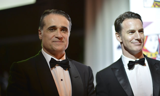 two older men wearing black tuxes and bow ties