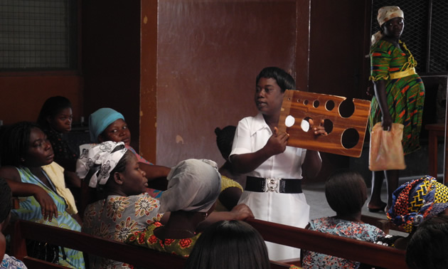 nurses and pregnant women in an African clinic