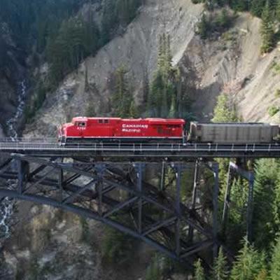 A CP Rail train travelling over a bridge.
