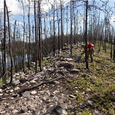 De Beers geologist collecting samples from esker at West Athabasca.