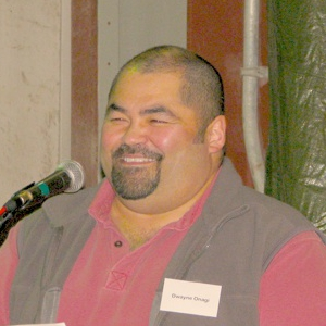 Photo of Dwayne Onagi standing at a podium