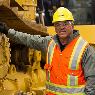 Tony de Sousa, standing next to a Finning Cat, will oversee Finning Canada's operations in Saskatchewan from Caterpillar's provincial headquarters in Regina.