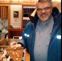 George Ross showing some gold nuggets that was mined near Dawson City by placer miners.