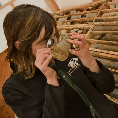 A Golden Predator employee checks out core samples from one of the company's mining projects.