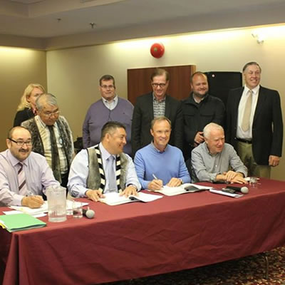 Members of the KIA and Agnico Eagle executive team sign the IIBA agreement in Rankin Inlet. Front row (left to right): Kono Tattuinee, Secretary Treasurer KIA, David Ningeongan, President KIA, Sean Boyd, Chief Executive Officer Agnico Eagle, Jim Nasso, Chair, Agnico Eagle