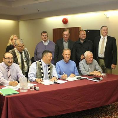 Members of the KIA and Agnico Eagle executive team sign the IIBA agreement in Rankin Inlet. Front row (left to right): Kono Tattuinee, Secretary Treasurer KIA, David Ningeongan, President KIA, Sean Boyd, Chief Executive Officer Agnico Eagle, Jim Nasso, Chair, Agnico Eagle