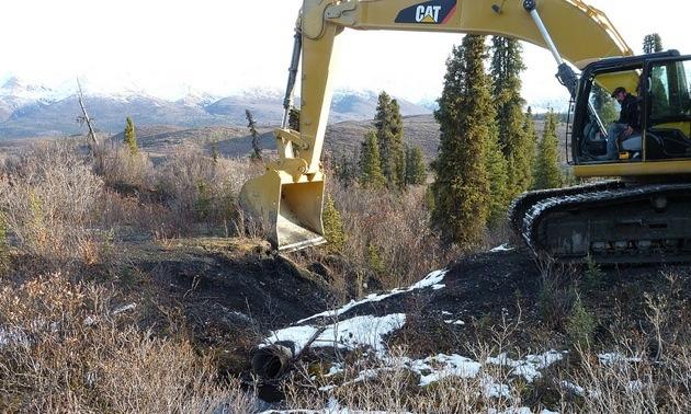 Equipment working on Howard's Pass Access Road near the Selwyn deposit in Yukon.