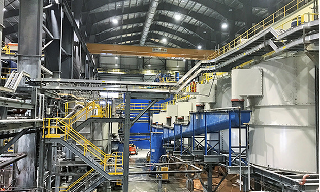 Inside of Brucejack Mine showing stairs and large industrial equipment.