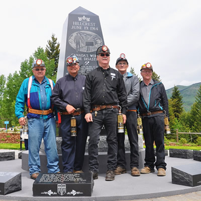 In 2014, John Kinnear (centre) stands in front of a memorial as part of a honour guard during the 100th anniversary of the Hillcrest Mine Disaster, when 189 men were lost.