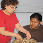 Katie Ludwig, a First Nations elder who lives in camp with students each summer, aids in cultural immersion.