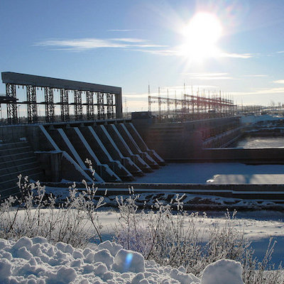La Grande dam in Quebec shown with a skiff of snow on the ground