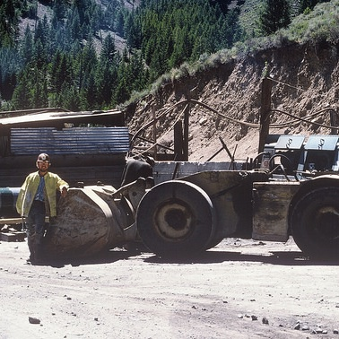 Lamarre stands beside a mucking machine, an underground mining vehicle for hauling ore, at the entrance to the Thompson Creek molybdenum mine near Challis, Idaho, in 1976.