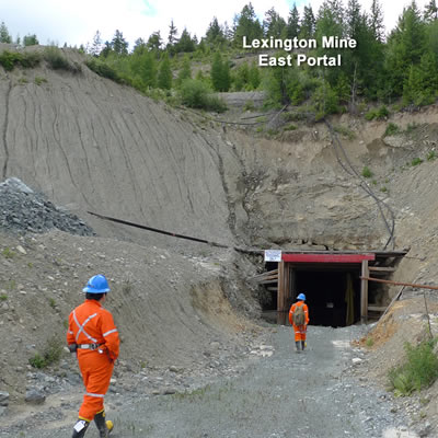 East portal into the Lexington Mine, workers walking in.