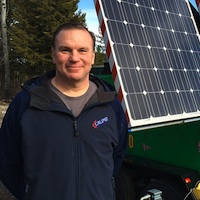 Mike Hambalek by Soleco's second generation solar and wind-powered light tower.