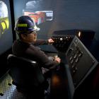 Trainees with MTS's Underground Mining Program utilize a $1.5 million simulator.