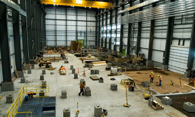 Inside the Concentrator building, showing large open area with workers.