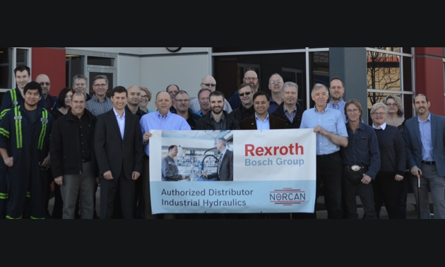 Staff at Norcan Fluid Power's Langley location join representatives from Bosch Rexroth to celebrate sole distribution deal for Western Canada.
