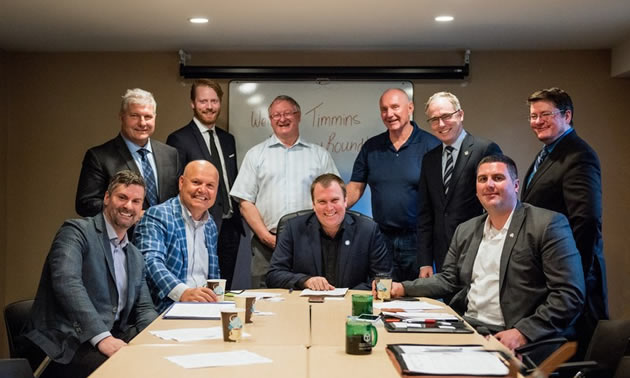 Chris Hodson, Cameron Grant, Bill MacRae, Tom Laughren, Kevin Edgson, Nick Stewart (first row), Derek Nighbor, Rocco Rossi, Mayor Steve Black and Paul-Emile McNab gathered in Timmins for a Resources Roundtable.
