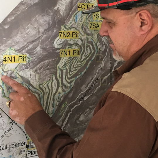 Mark Bartkoski points to a site of interest on a mining exploration/resource map.
