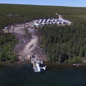Aerial view of the Rook 1 camp with a sea plane at the doc on Patterson Lake.