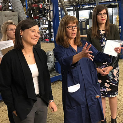 L-R: Minister Shannon Phillips, Lisa Doig, MLA Jessica Littlewood and Lorraine Mitchelmore discuss the reactor process at the plant site in Fort Saskatchewan.