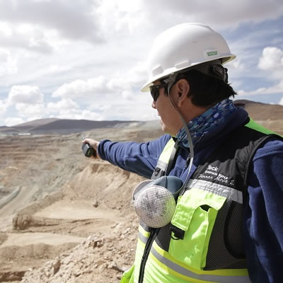 Worker at Quebrada Blanca Phase 2 mine project.