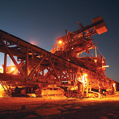 Nighttime picture of equipment at copper mine