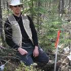Photo of a man doing a soil sample
